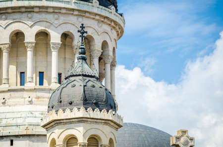 napoca: Detail of Orthodox Cathedral in Cluj Napoca, Transylvania region of Romania with the beautiful towers and roof on a blue cloudy sky suggesting peace and religion