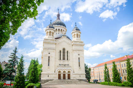 Orthodox Cathedral in Cluj-Napoca Avram Iancu Square in the Transylvania region of Romania on a beautiful sunny summer day with a blue cloudy sky