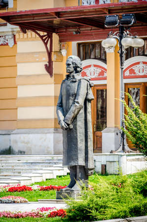 Statue of Mihai Eminescu, national Romanian poet famous for his nationalist and patriotic poetry. Statue is placed in front of the Cluj-Napoca National Theatre, in Avram Iancu square in the Transylvania region of Romania