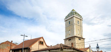 View of the old firemans tower, one of the few remaining towers from the old Cluj Napoca medieval defence walls, extended and used in more recent times as a watchtower. A mixture of medieval, baroque and modern architecture Stock Photo