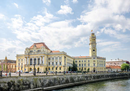 10 September 2016 - Oradea, Romania: City town hall Palace built in eclectic architectural style on the side of the Crișul Repede river