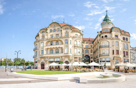 10 September 2016 - Oradea, Romania: Black Eagle ( Vulturul Negru ) secession Palace with terraces in front on a beautiful sunny day