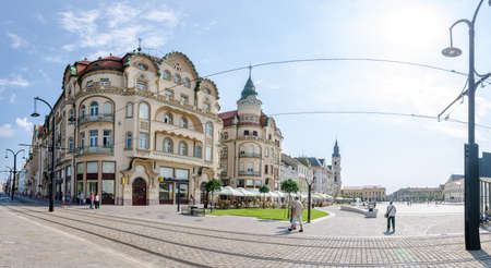 10 September 2016 - Oradea, Romania: Black Eagle Complex Palace ( Vulturul Negru ) in the Unirii Square of the city built in secession style and the tram lines running in front on the pedestrian area Editorial