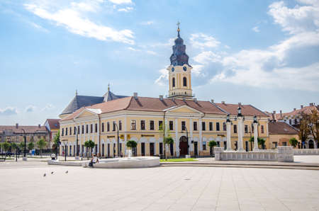 10 September 2016 - Oradea, Romania: Unirii Square with the Kovats House built in classicist architectural style and the tower from the Greek Catholic Christian Baroque Church Editorial