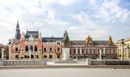 10 September 2016 - Oradea, Romania: Mihai Viteazu (Michael the Brave) Statue in the Unirii SDquare with the Greek-Catholic Episcopal Palace on the background in this wonderful East European city Editorial