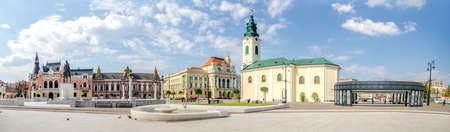 10 September 2016 - Oradea, Romania: Unirii Square with the statue of Romanian Hero Mihai Viteazul, the St. Ladislau Baroque Church, the Town Hall and the Greek Catholic Episcopal Palace on a beautiful autumn day Editorial