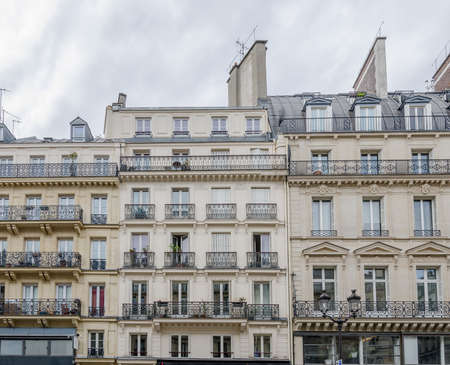 Generic Paris buildings with typical parisian attics and dormer windows and beautiful balconeys in this beautiful european city