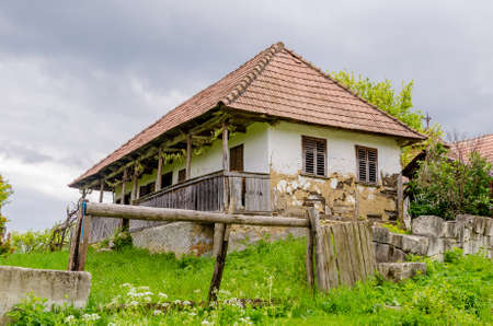 Traditional abandoned transylvanian adobe house in a rural area with a sad degrading look