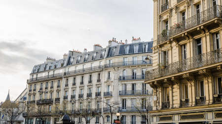 Typical street view from paris with beautiful classic buildings in this wonderful european destination on a bright sunset