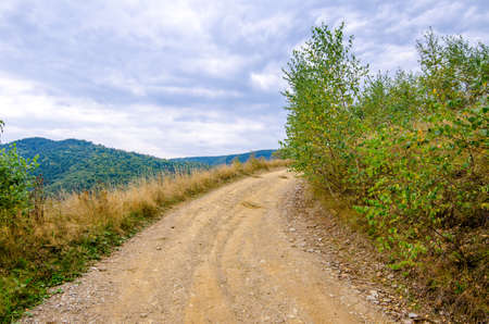Unpaved rural road on a high mountain peak in Transylvania region of Romania