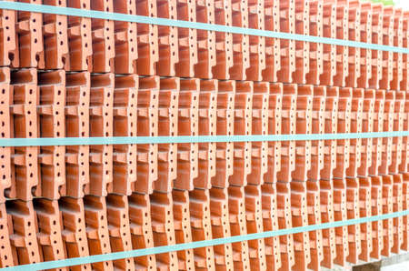 Ceramic roof tiles in a stack on a construction site