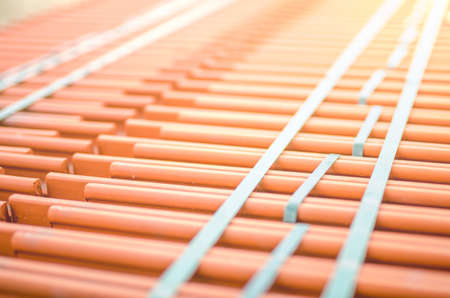Ceramic roof tile shingles in a stack on a construction site or deposit ready to be transported and put on a building