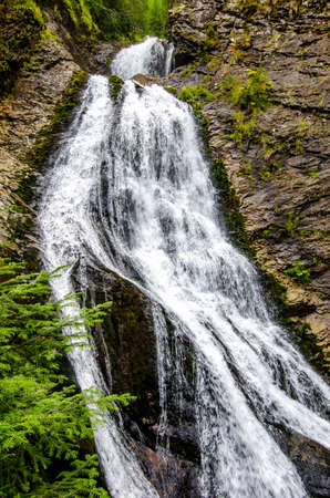 Bride's Vail waterfall in Transylvania region of Romania with fresh pure clean water flowing of a cliff