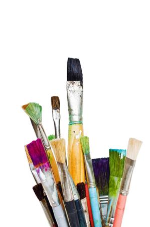 Oude en gebruikte kleurrijke penselen Stockfoto