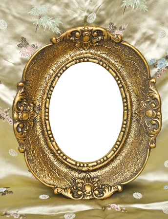 Golden frame on silk floral background photo