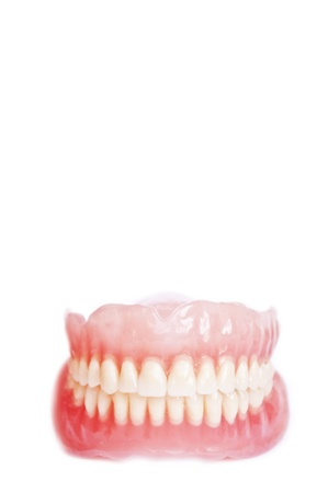 Denture isolated on white  photo