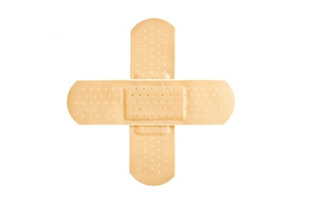 Adhesive first-aid bandage in cross shape  photo