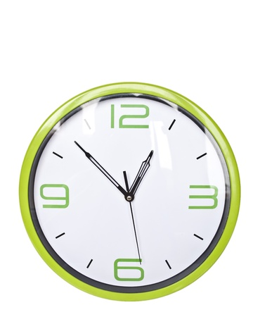 Green retro wall clock isolated on white photo