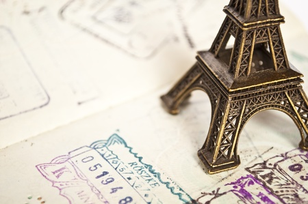 foreign national: Stamped passport with Eiffel passport - travel to Paris concept