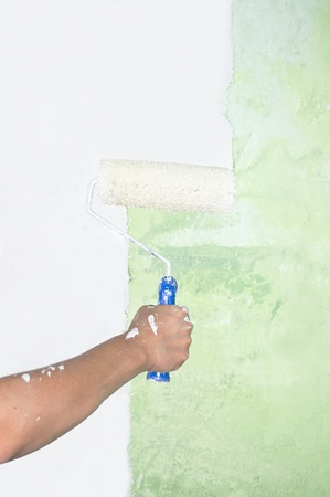 Hand painting on wall with roller  photo