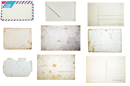 Set of grunge empty postcards and envelopes isolated on white background photo
