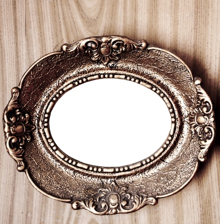Empty golden vintage frame on wooden wall  photo