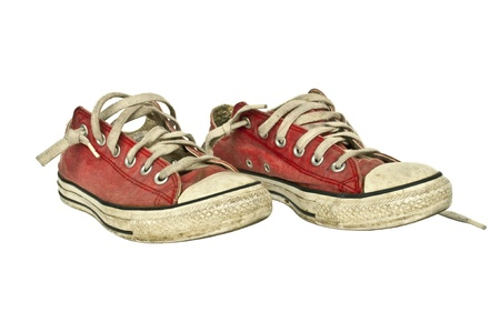 gym shoes: Old red sneakers