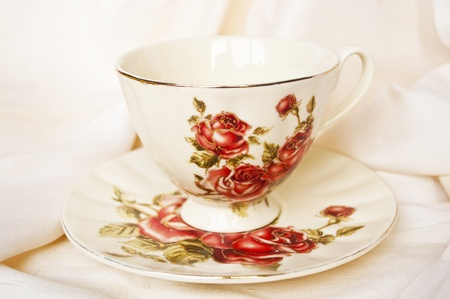 Antique tea cup with roses  photo