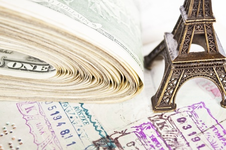 Travel concept - stamped passport,dollars and Eiffel tower photo