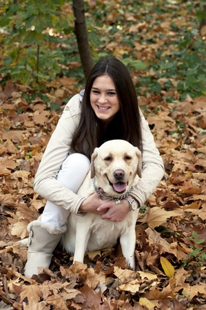 Young beautiful girl and her dog Stock Photo - 11388348
