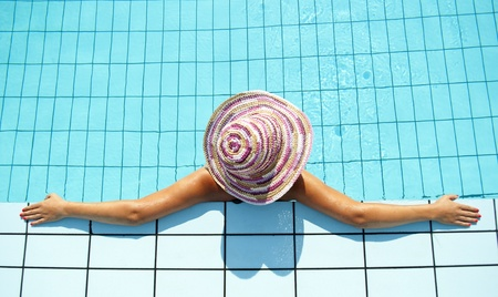 Woman enjoying in swimming pool  photo