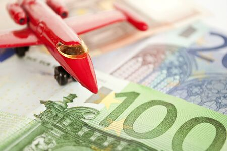 Close up view on airplane and euro bank notes - Travel with airplane concept photo