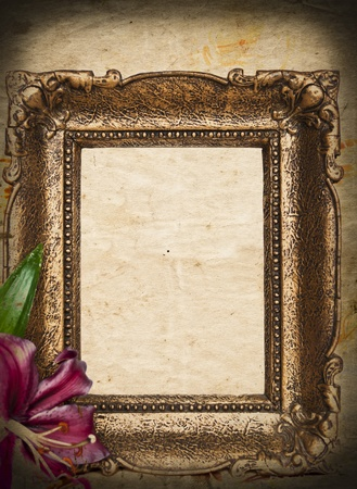 Vintage golden frame on grunge background photo