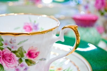 Antique floral tea set macro shot photo