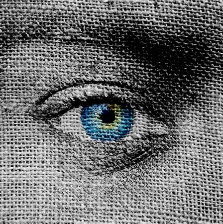 Blue eye on canvas background photo