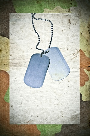 Grunge army background with ID tags photo