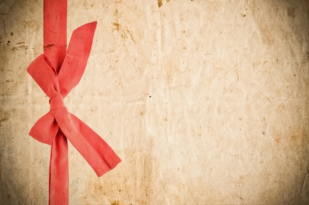 Grunge paper with red bow photo