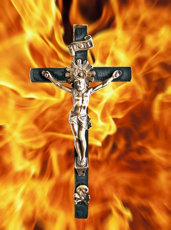Jesus Chrit cross against fire flames photo