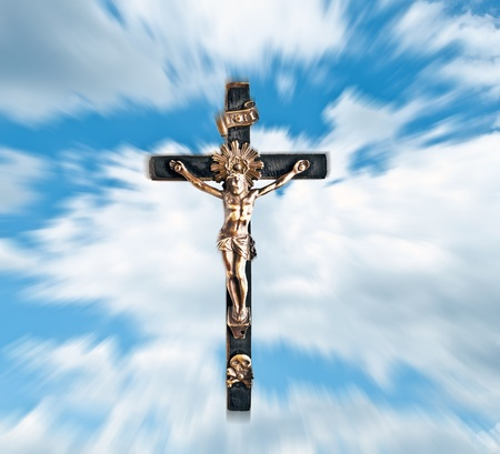 Jesus Christ against blue sky and clouds Stock Photo