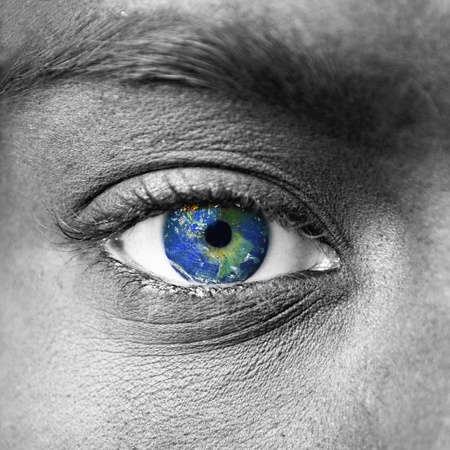 Planet earth in blue human eye photo