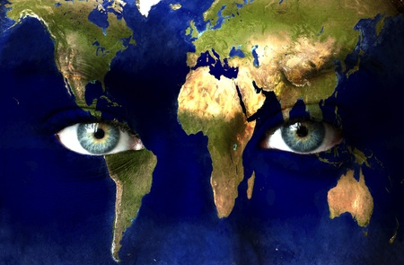 Planet earth and blue human eyes photo