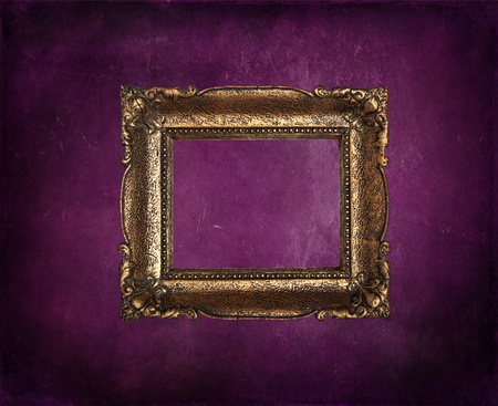 Antique picture frame on purple grunge wall photo