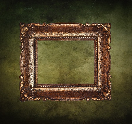 Antique picture frame on grunge wall photo