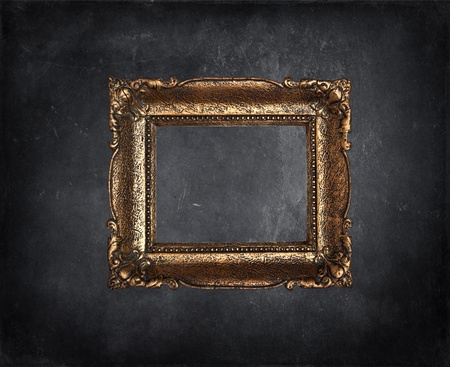 Antique picture frame on black grunge wall Stock Photo - 11699908