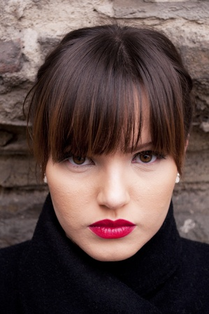 Portrait of beautiful woman with make-up and red lipstick photo