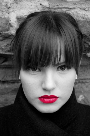 Fashion model portrait in black and white with red lips photo