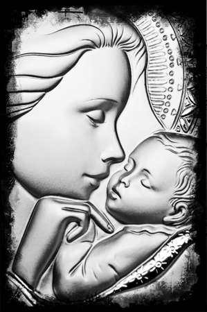 Virgin Mary holding baby Jesus in arms Stock Photo - 12040692