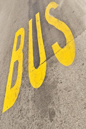 Yellow Bus sign painted on the asphalt  photo