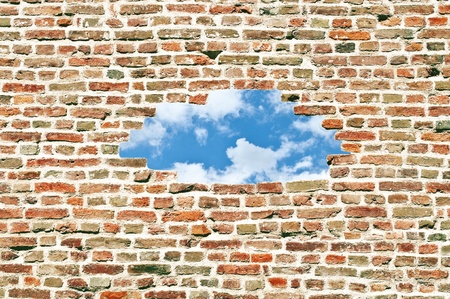 Brick wall and whole with sky in center Stock Photo - 12041040