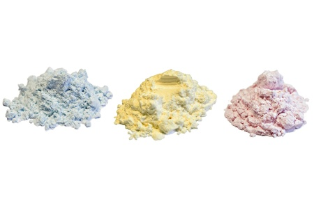 Colorful make-up powders isolated on white photo